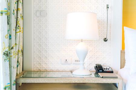 bedside: Light lamp decoration on bedside in bedroom interior Stock Photo