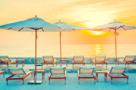 hotel resort: Beautiful luxury hotel swimming pool resort with umbrella and chair - Vintage filter