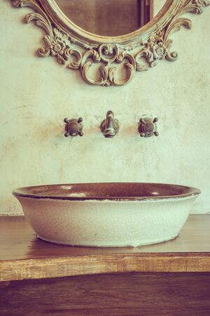 decoration objects: Vintage bathroom decoration with faucet and mirror - Vintage Filter Stock Photo