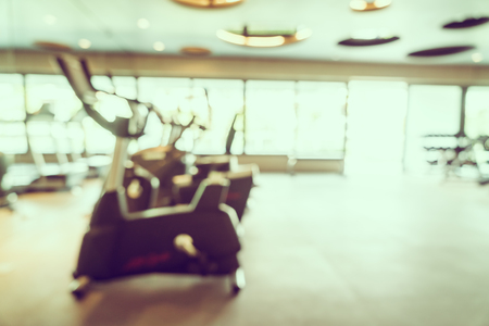 gym room: Abstract blur fitness and gym room interior background - Vintage filter Stock Photo