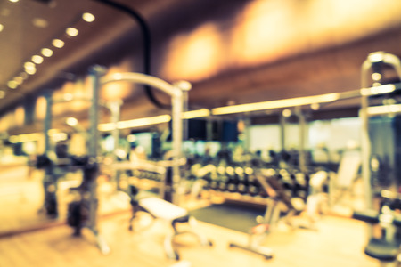 recreation room: Abstract blur fitness gym room interior background - Vintage filter