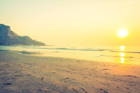 Beautiful sunrise on the tropical beach and sea landscape - Vintage Filter