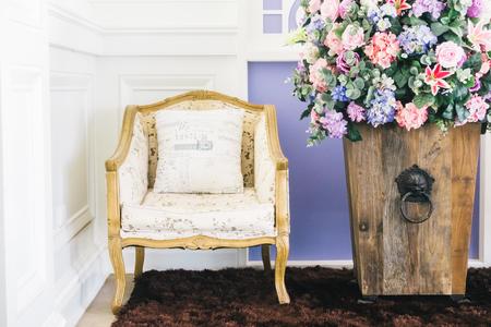 Beautiful vase flower and empty chair decoration interior of livingroom - Vintage Film filter