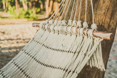 hamaca: Empty hammock on the beach - Vintage Filter Foto de archivo