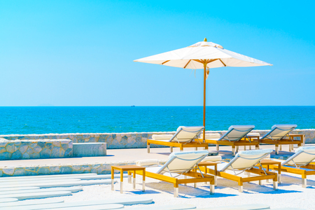 resort: Beautiful luxury hotel swimming pool resort with umbrella and chair Stock Photo