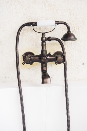 bathtub old: Old vintage faucet on bathtub decoration in bathroom interior - Light Vintage Filter