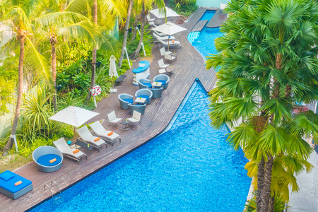 paradise beach: Aerial view of Beautiful luxury hotel swimming pool resort with umbrella and chair - Boost up color processing
