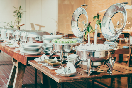 buffet dinner: Selective focus point on Catering buffet in hotel restaurant - Vintage filter effect Stock Photo