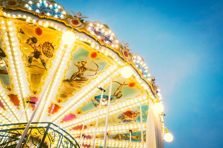 play the old park: Vintage Carousel horse amusement attraction in the park - Vintage Filter Stock Photo