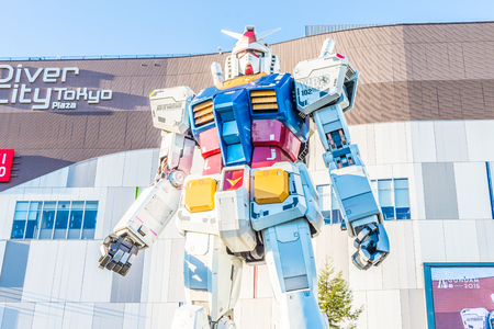 replica: TOKYO, JAPAN - November 27,2015 : Gundam Statue Model Performances Outside DiverCity Tokyo Plaza, Odaiba, Tokyo, Japan. It is 18m of tall and is the tallest replica of famous robot, Gundam. Stock Photo