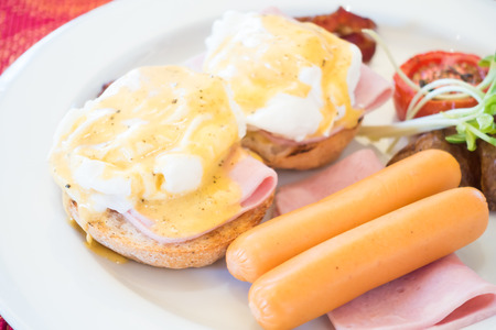benedict: Eggs Benedict set for breakfast in morning - Soft focus point Stock Photo