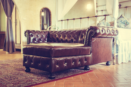 livingroom: Vintage leather sofa decoration in livingroom interior - Vintage Filter