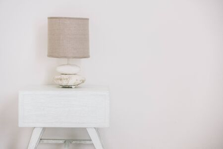 bedside lamps: Table with light lamp decoration in livingroom interior - Vintage Light filter Stock Photo
