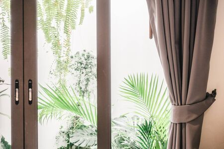 living room window: Curtain window decoration in living room interior - Vintage Filter