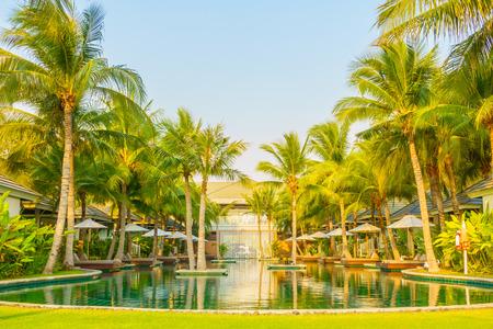 hotel resort: Beautiful luxury Umbrella and chair around swimming pool in hotel pool resort - Vintage Light Filter