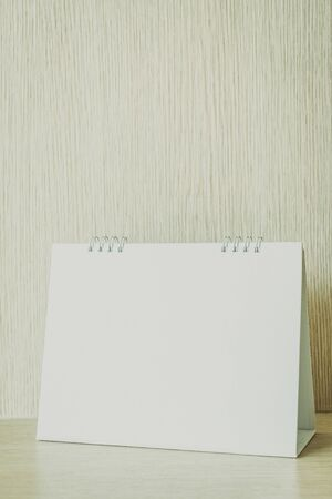 Blank calendar on wooden background - Vintage filter Stock Photo