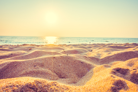Beautiful beach sand and sea at sunset times with copy space for background - Vintage Filter and Boost up color Processing