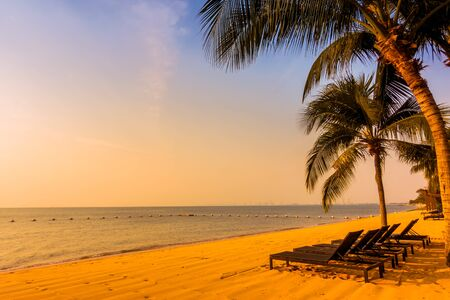 tropical beach: Beautiful tropical beach sea and sand with palm tree for background - Vintage Filter Stock Photo