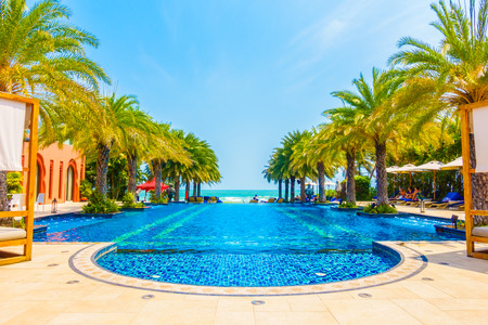 hotel: Beautiful luxury swimming pool in hotel pool resort - Boost up color Processing