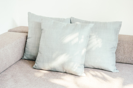 white pillow: Pillow on sofa and chair decoration in living room interior - Vintage Light Filter