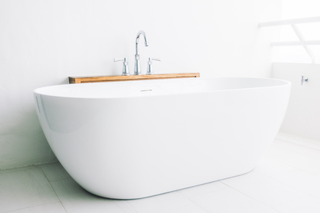 Beautiful luxury white modern bathtub decoration in bathroom interior - Filter effect Archivio Fotografico