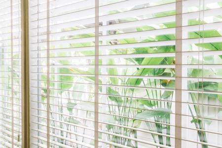 horizontal: Selective focus point on Blinds window decoration in livingroom interior - Vintage Light Filter