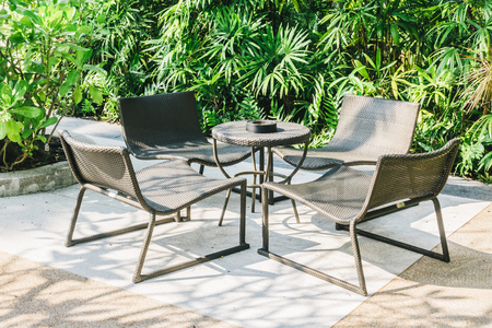 patio: Outdoor patio with empty chair and table - Vintage Light Filter Stock Photo