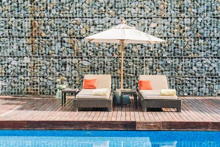 seaside resort: Umbrella and chair deck in hotel resort swimming pool - Filter effect