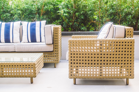 Sofa pillow and chair decoration with outdoor patio - Vintage Light Filter 免版税图像