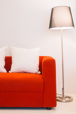 red sofa: Red sofa with pillow and light lamp decoration in living room interior - Vintage Light Filter