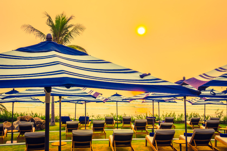 el sheikh: Beautiful luxury outdoor swimming pool in hotel resort with silhouette umbrella and chair and coconut palm tree - Vintage Filter and Boost up color Processing
