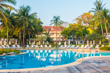 hotel resort: Beautiful luxury outdoor swimming pool with umbrella and chair in hotel resort Editorial