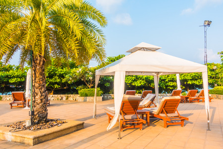 hotel resort: Umbrella and chair around swimming pool in hotel resort - boost up color Processing