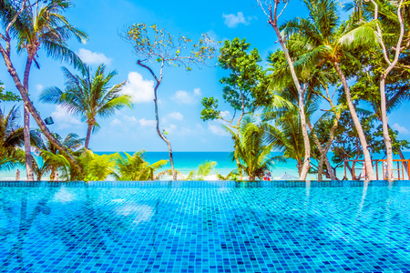 porch scene: Beautiful luxury Umbrella pool and chair around swimming pool neary beach and sea in hotel resort - Boost up color Processing