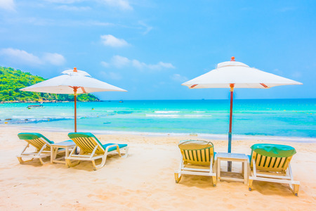 Beautiful tropical beach and sea landscape with coconut palm tree and umbrella and chair - Boost up color Processing Stock Photo