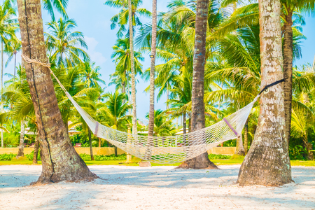 cayman islands: Empty hammock on beautiful tropical beach and sea with coconut palm tree - Boost up color Processing Stock Photo