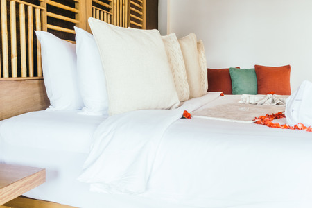 heart suite: Swan towel and rose flower with beautiful luxury pillow decoration on bed in bedroom interior - Vintage light Filter