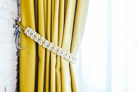 yellow tassel: Beautiful luxury Window curtains decoration in bedroom interior with copy space for background - Vintage Light Filter Stock Photo
