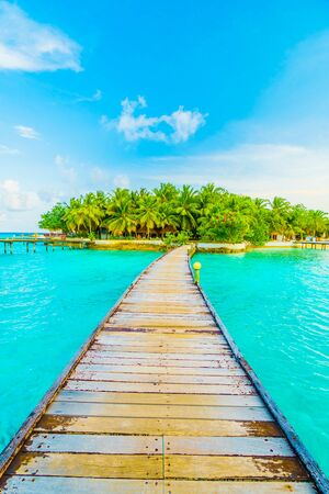 island paradise: Beautiful tropical Maldives resort hotel and island with beach and sea on sky for holiday vacation background concept -Boost up color Processing Stock Photo