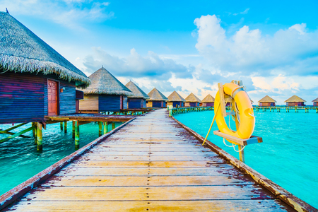 island paradise: Beautiful tropical Maldives resort hotel and island with beach and sea on sky for holiday vacation background concept -Boost up color Processing Editorial