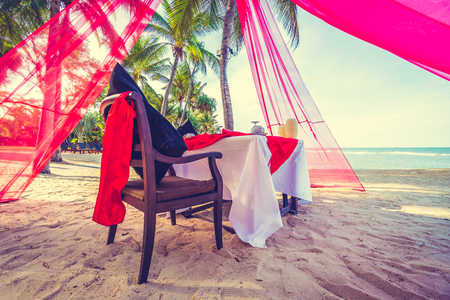 romantic beach: Romantic dinner setting on the tropical beach and sea - Vintage Filter Stock Photo