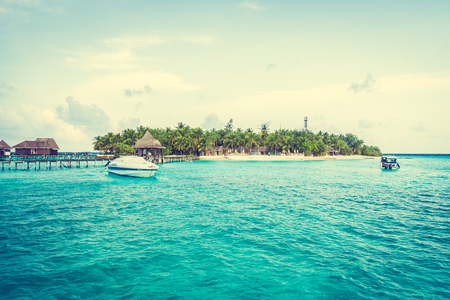 resort beach: Beautiful tropical Maldives resort hotel and island with beach and sea on sky for holiday vacation background concept -Boost up color Processing Editorial