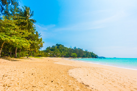 Beautiful tropical beach and sea landscape with coconut palm tree and blue sky background - Boost up color Processing Stock Photo