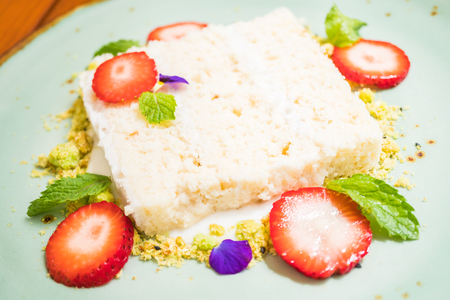 three layer: Sweet dessert with Coconut cake with strawberry on top