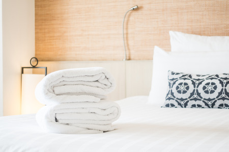 laundered: Bath towel for take a shower on bed decoration in bedroom interior