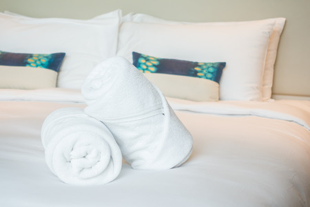 house robes: White bath towel on bed decoration in bedroom interior Stock Photo