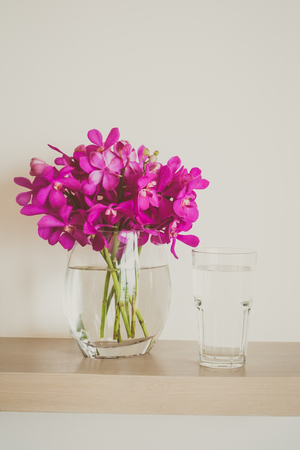 Water Glass With Orchid Flower Vase Vintage Filter Stock Photo
