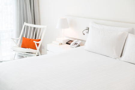 white pillow: White pillow on bed with table light lamp decoration in bedroom interior Stock Photo
