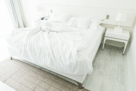 white pillow: White pillow on rumpled bed decoration in bedroom interior