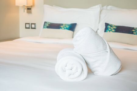 house robe: White bath towel on bed decoration in bedroom interior Stock Photo